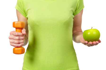 svelte: Woman with a dumbbells and apple. Isolated white background