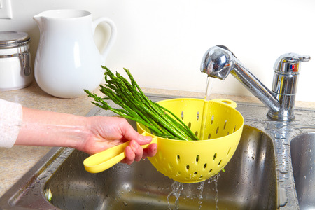 bolter: Vegetarian food in the sink. Fresh asparagus Stock Photo