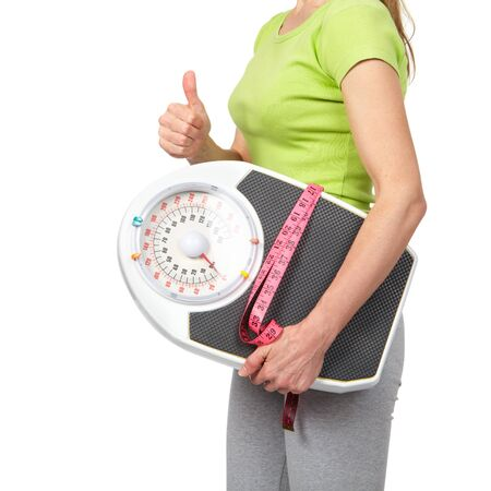 svelte: Woman with scales. Isolated white background. Diet, healthy lifestyle. Stock Photo