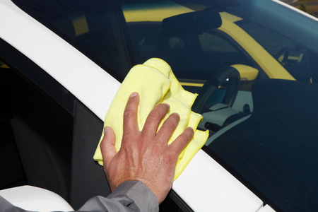 rag wheel: Cleaning the car. Hand with microfiber cloth.