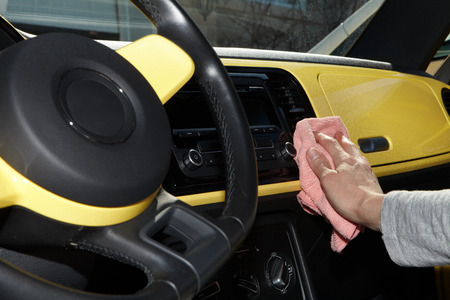 microfiber: Cleaning the car. Hand with microfiber cloth.