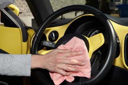 neatness: Cleaning the car. Hand with microfiber cloth.