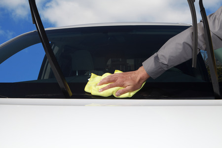 neatness: Car Wash. Hand with microfiber cloth. Service Stock Photo