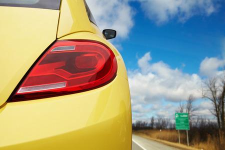 Car headlights on a modern yellow car