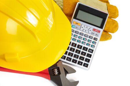 yellow helmet: Yellow helmet and electronic calculator. Tools builder