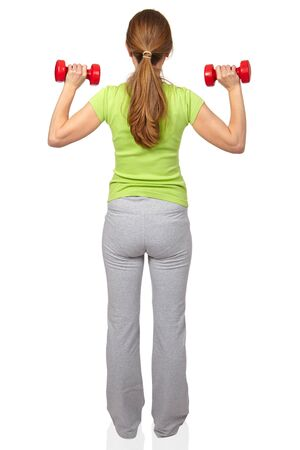 Woman with a dumbbells. Isolated white background