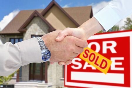 handclasp: New home for sale. Consent and handshake Stock Photo