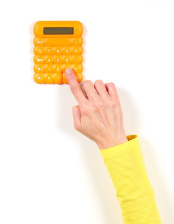 Hands in yellow jacket and yellow calculator on white background