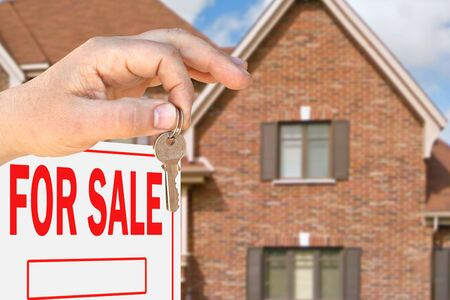 apartment for rent: Home for sale. Sign in front of beautiful new home Stock Photo
