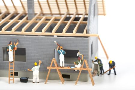 plasterer: Construction of cottage. Workers in the construction of a house Stock Photo