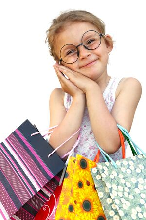Little girl with shopping bags. Isolated over white background