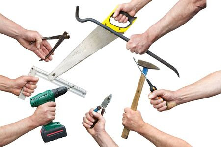 Hands of workers with tool kit on a white background Stock Photo