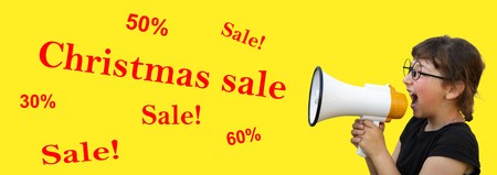 Little girl shouting by megaphone on yellow background. Sale and Christmas
