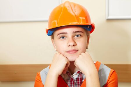 Young contractor relaxing in the office. Construction Banque d'images