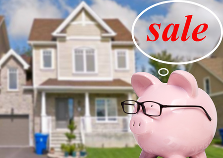 Pig bank and thoughts about buying a house 스톡 콘텐츠