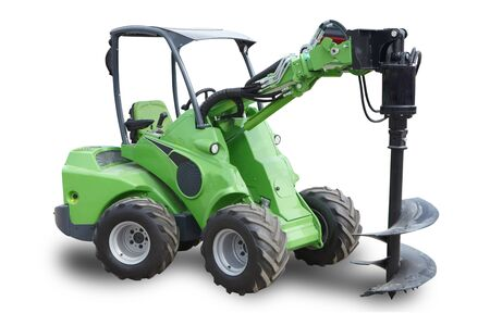 Green wheeled agricultural tractor on white background