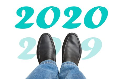 Man in black boots and 2020 new year