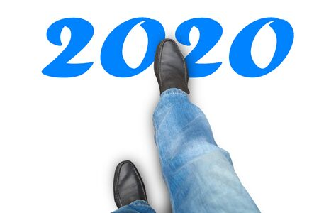 Man in shoes takes a step. New Year 2020 版權商用圖片