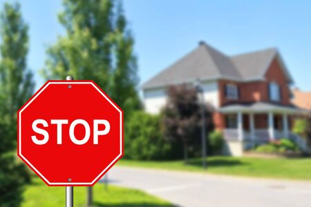 Stop sign at an intersection with a street in the background 写真素材