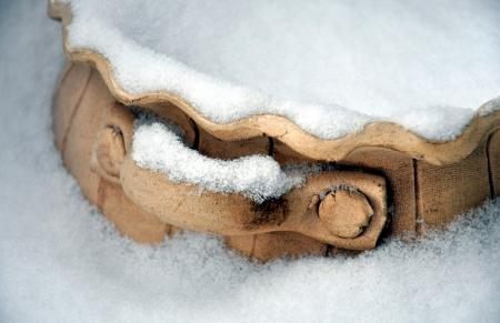 crock: crock in the snow Stock Photo