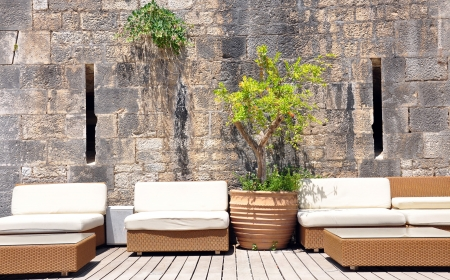 upholstered sofa with stone walls