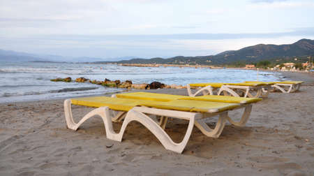 loungers: free sun loungers on the beach near the sea