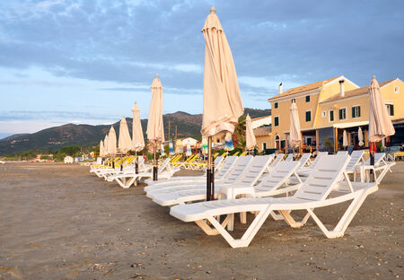 loungers: parasols and sun loungers on the beach in summer