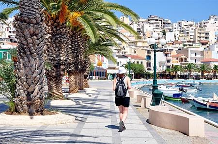 promenade: Woman and promenade in Sitia, Crete, Greece