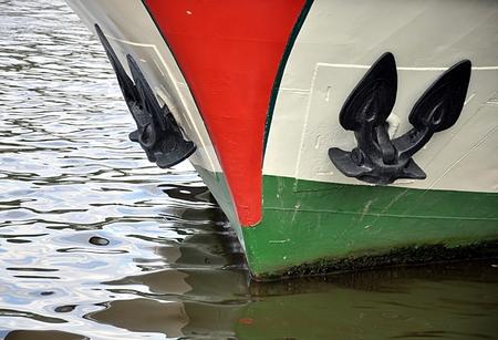 ship anchor: Anchor and boat
