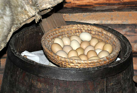eggs and old wooden barrel