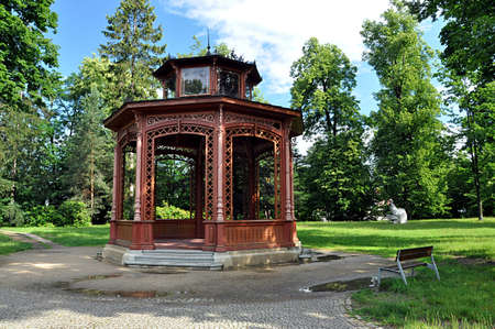 wooden gazebo and park
