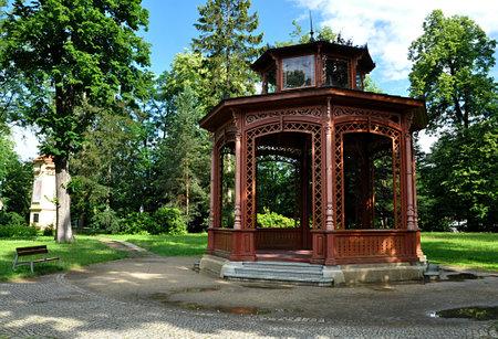 old wood gazebo and park