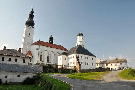 church and city Branna, Czech republic, Europe Standard-Bild