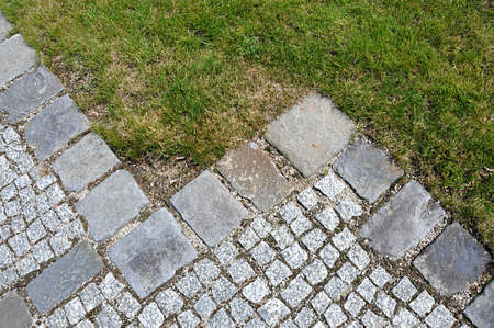 stone walkway and green grass