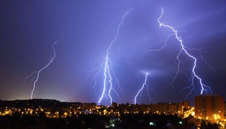 bolt: lightning, night storm in town Stock Photo