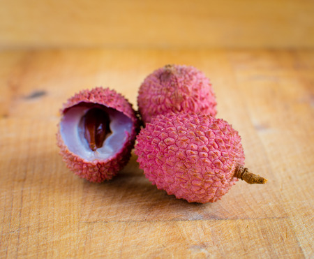 Lychee on a wooden table.
