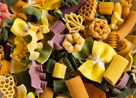 Multicolored italian pasta, horizontal background Stock Photo