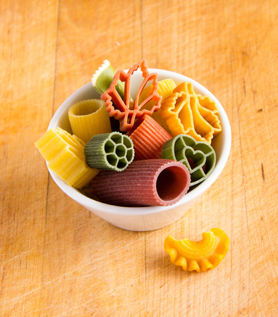 Multicolored italian pasta in bowl Stock Photo