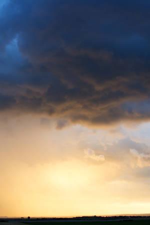 dramatically: Sky with dramatically illuminated stormy clouds
