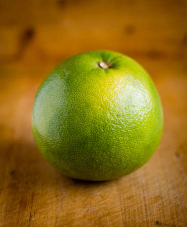 White grapefruit on wooden background