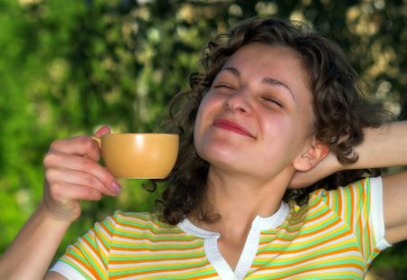 Pretty woman is drinking coffee in the morning Stock Photo - 2005182