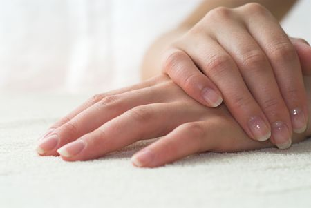 Nice hands on white towel. Soft manicure. Stock Photo