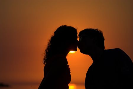 Young couple is kissing on the beach Stock Photo - 2009393