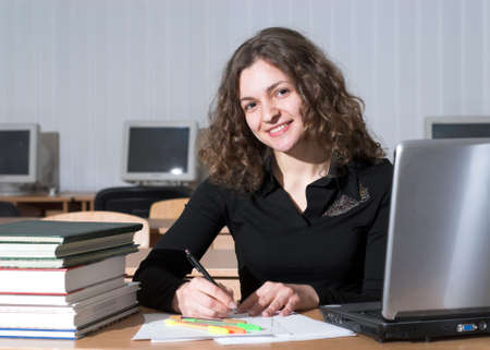 Attractive female student is preparing to the test. photo