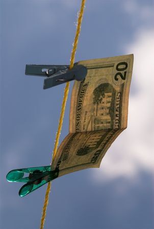 Money is hanging on clothes line in the air photo