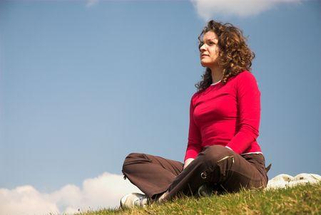 joga: Pretty female is sitting in pose of joga. Stock Photo