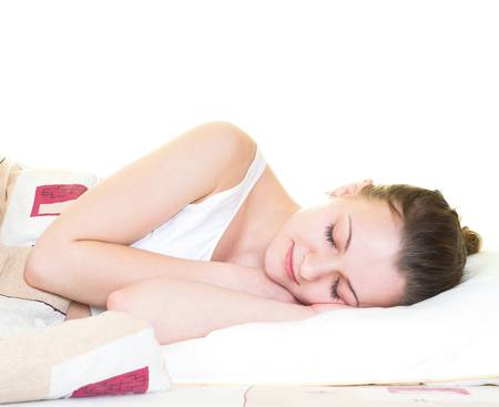 Young woman is sleeping in her bed. Isolated. Stock Photo - 2513566