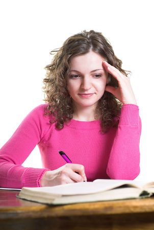 Young student is writing a paper. Isolated. Stock Photo - 2550442