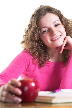 Businesswoman is making decision holding apple. Isolated. photo