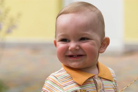 Smiling boy portrait on blurred background Stock Photo - 5495547